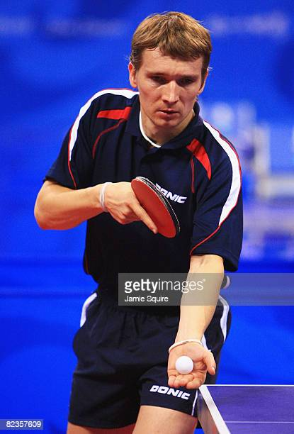 Werner Schlager of Austria serves against Andrej Gacina of Croatia during their Men's Team Bronze Playoff Round 1 at the Peking University Gymnasium...