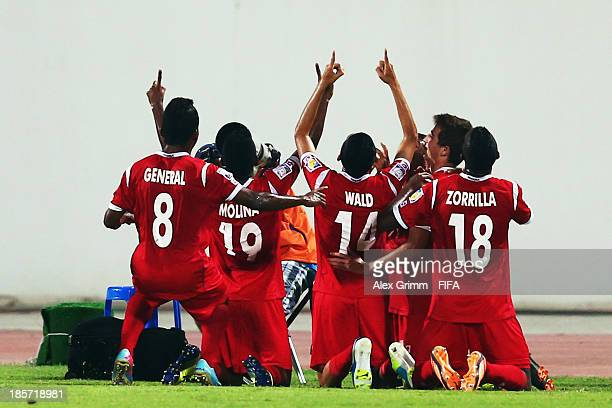 Werner Wald of Panama celebrates his team's first goal with team mates during the FIFA U17 World Cup UAE 2013 Group C match between Morocco and...