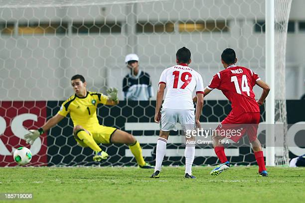 Werner Wald of Panama scores his team's first goal against Taoufiq Naciri and goalkeeper Oussayd Belkouch of Morocco during the FIFA U17 World Cup...