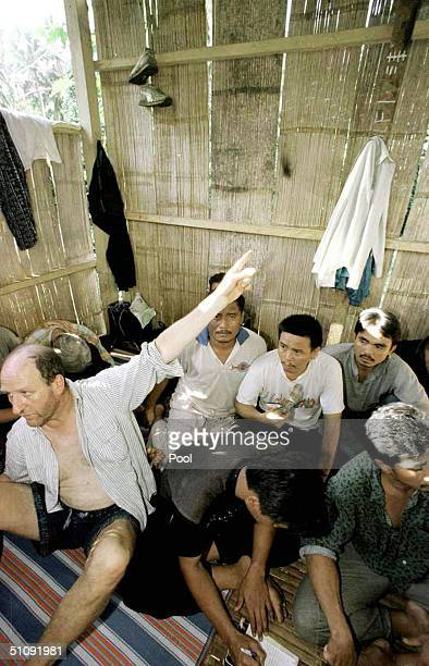 Werner Wellert Of Germany Points Towards Chalk Marks Counting The Number Of Days Held Captive As He Sits Beside Malaysian Hostages While Being...