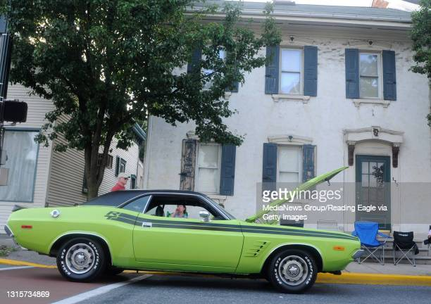 Wernersville resident Dawyne Boyer's 1973 sublime green Dodge Challenger has its hood popped for passers by.Hundreds attend the Muscles on Main car...