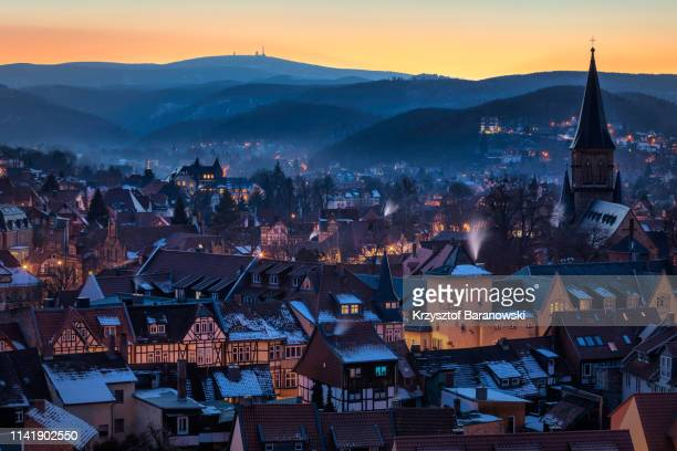 wernigerode with brocken at sunset - saxony anhalt stock pictures, royalty-free photos & images