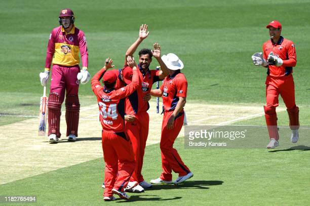 Wes Agar of South Australia celebrates taking the wicket of Matthew Renshaw of Queensland during the Marsh One Day Cup match between Queensland and...