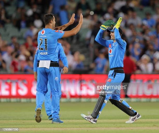 Wes Agar of the Adelaide Strikers and Alex Carey of the Adelaide Strikers celebrate during the Big Bash League match between the Adelaide Strikers...