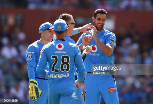 Wes Agar of the Strikers celebrates with team mates after taking the wicket of Ben Laughlin of the Heat during the Big Bash League match between the...