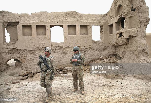Wes Brockbank from Seattle, Washington with the U.S. Army's 4th squadron 2nd Cavalry Regiment and his interpreter walk through a village during a...