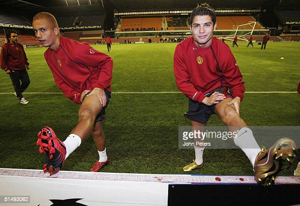 Wes Brown and Cristiano Ronaldo of Manchester United warm up during a training session ahead of the UEFA Champions League match between Sparta Prague...