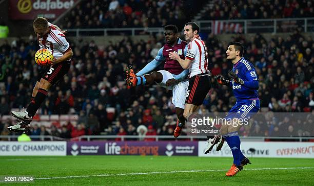 Wes Brown and John O' Shea of Sunderland combine to thwart Michah Richards of Aston Villa during the Barclays Premier League match between Sunderland...