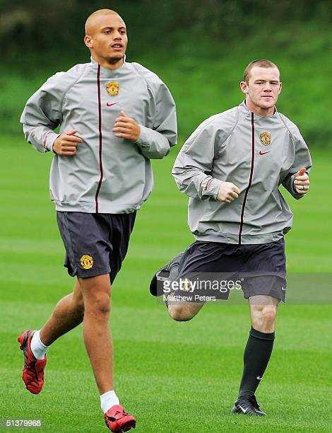 Wes Brown and Wayne Rooney in action during a first team training session at Carrington Training Ground on October 1, 2004 in Manchester, England.