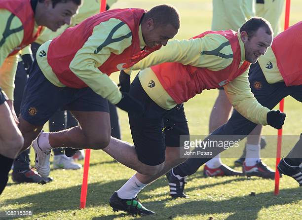 Wes Brown and Wayne Rooney of Manchester United in action during a first team training session at Carrington Training Ground on January 21, 2011 in...