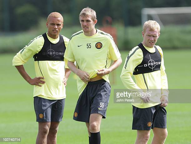 Wes Brown, Darren Fletcher and Paul Scholes of Manchester United in action during a First Team Training Session at Carrington Training Ground on July...