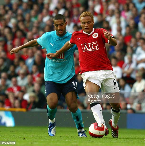 Wes Brown of Manchester United and Mido of Tottenham Hotspur in action during the Barclays Premiership match between Manchester United and Tottenham...