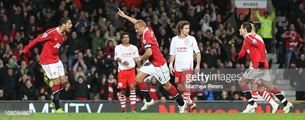 Wes Brown of Manchester United celebrates scoring their first goal during the FA Cup sponsored by Eon Fifth Round match between Manchester United and...