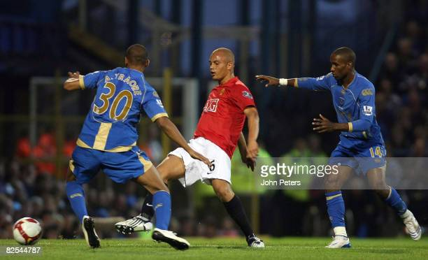 Wes Brown of Manchester United clashes with Armand Traore and Jermain Defoe of Portsmouth during the FA Premier League match between Portsmouth and...