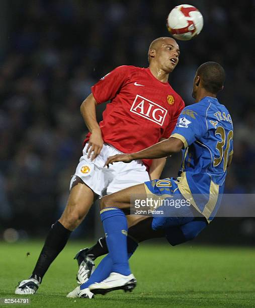 Wes Brown of Manchester United clashes with Armand Traore of Portsmouth during the FA Premier League match between Portsmouth and Manchester United...