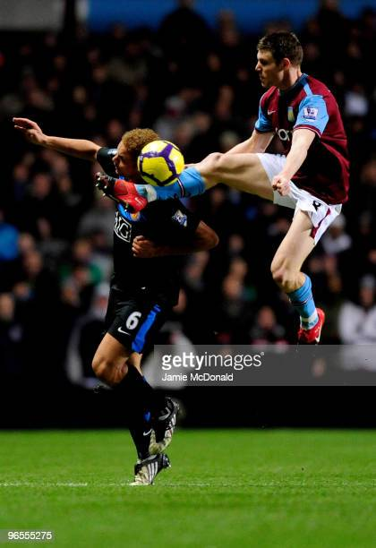 Wes Brown of Manchester United clashes with James Milner of Aston Villa during the Barclays Premier League match between Aston Villa and Manchester...