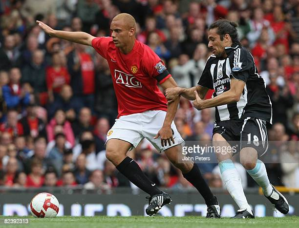 Wes Brown of Manchester United clashes with Jonas Gutierrez of Newcastle United during the FA Premier League match between Manchester United and...
