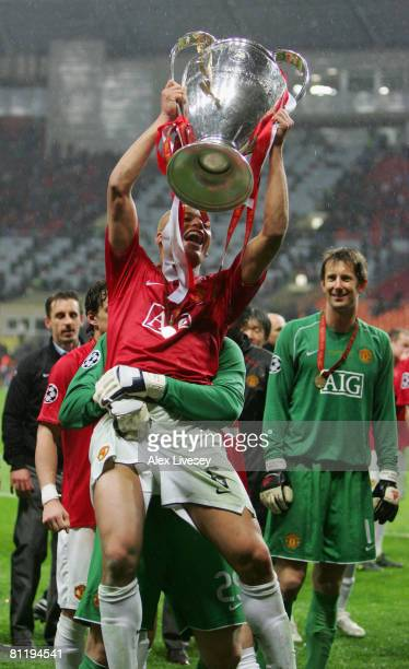 Wes Brown of Manchester United holds the trophy after the UEFA Champions League Final match between Manchester United and Chelsea at the Luzhniki...