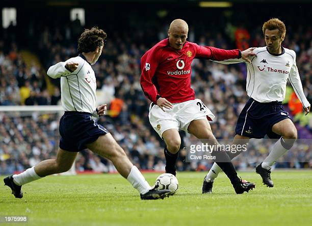 Wes Brown of Manchester United is challenged for the ball by Mauricio Taricco and Kazuyuki Toda of Tottenham Hotspur during the FA Barclaycard...
