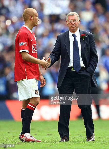 Wes Brown of Manchester United is consoled by Sir Alex Ferguson following defeat in the FA Cup Final match sponsored by E.ON between Manchester...