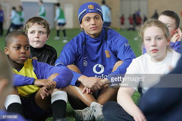 Wes Brown of Manchester United poses with local schoolchildren after the press conference to announce the club's plans to celebrate the 50th...