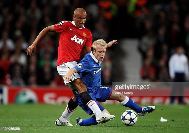 Wes Brown of Manchester United tangles with Steven Naismith of Rangers during the UEFA Champions League Group C match between Manchester United and...