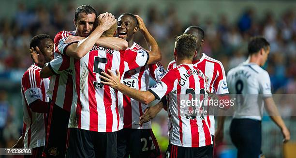 Wes Brown of Sunderland celebrates with team-mates after scoring a goal during the Barclays Asia Trophy Semi Final match between Tottenham Hotspur...