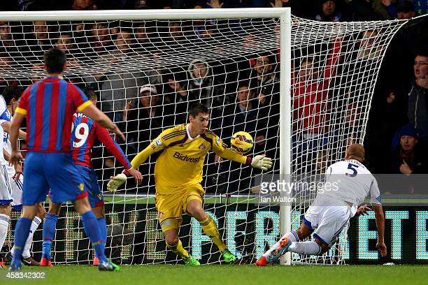 Wes Brown of Sunderland scores an own goal past teammate Costel Pantilimon of Sunderland to level the scores at 1-1 during the Barclays Premier...