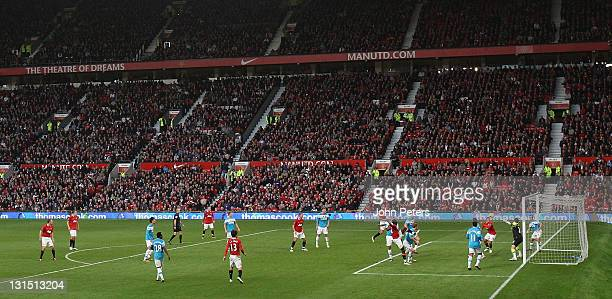 Wes Brown of Sunderland scores an own-goal during the Barclays Premier League match between Manchester United and Sunderland at Old Trafford on...