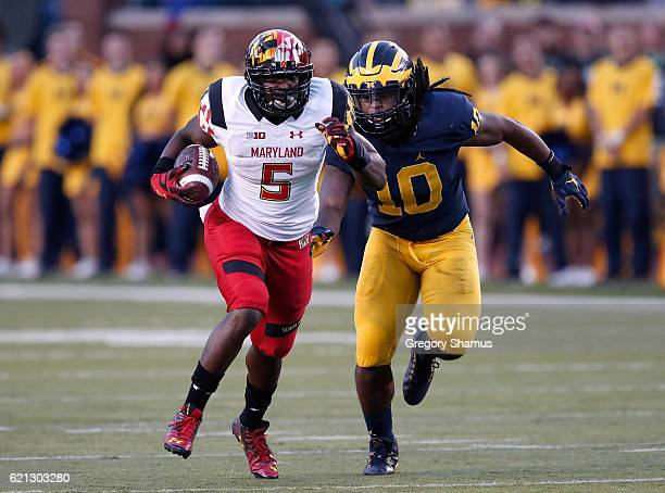 Wes Brown of the Maryland Terrapins tries to outrun Devin Bush of the Michigan Wolverines after a second half catch on November 5 2016 at Michigan...