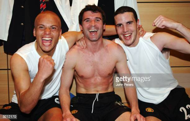 Wes Brown Roy Keane and John O'Shea celebrate in the dressing room after winning the AXA FA Cup match between Manchester United and Arsenal at Villa...