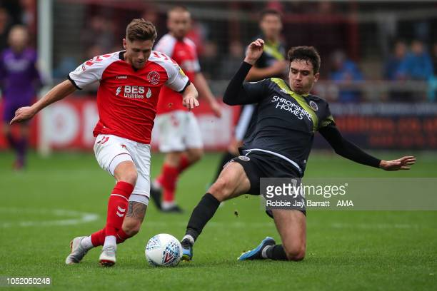 Wes Burns of Fleetwood Town and Alex Gilliead of Shrewsbury Town during the Sky Bet League One match between Fleetwood Town and Shrewsbury Town at...