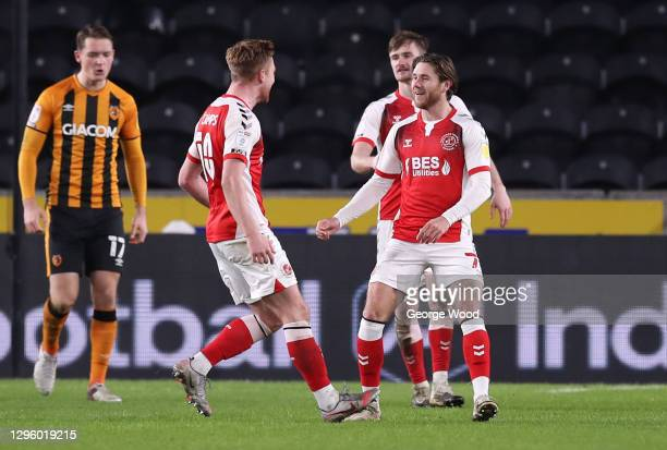 Wes Burns of Fleetwood Town celebrates with Callum Camps after scoring their team's second goal during the Papa John's Trophy match between Hull City...