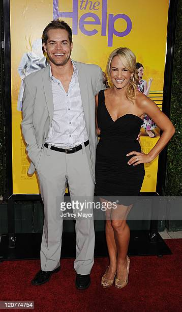 Wes Chatham and Jenn Brown attend The Help Los Angeles Premiere at AMPAS Samuel Goldwyn Theater on August 9 2011 in Beverly Hills California