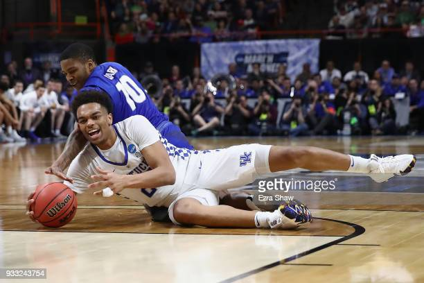 Wes Clark of the Buffalo Bulls and PJ Washington of the Kentucky Wildcats battle for a loose ball during the second half in the second round of the...