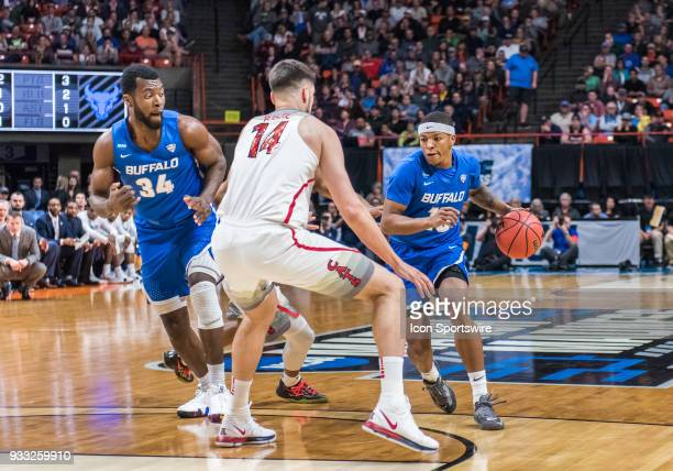 Wes Clark of the Buffalo Bulls goes up against C Dusan Ristic of the Arizona Wildcats during the NCAA Division I Men's Championship First Round game...