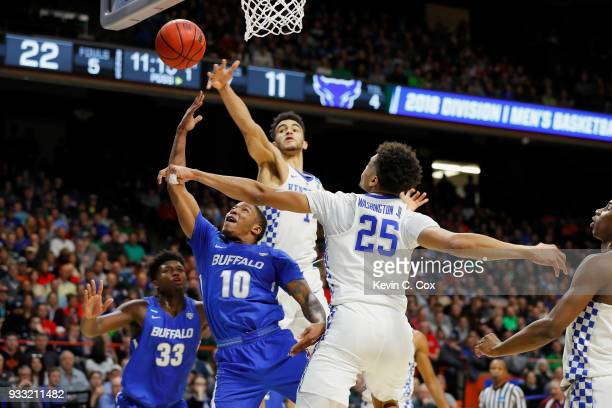Wes Clark of the Buffalo Bulls shoots the ball against Sacha KilleyaJones and PJ Washington of the Kentucky Wildcats during the first half in the...