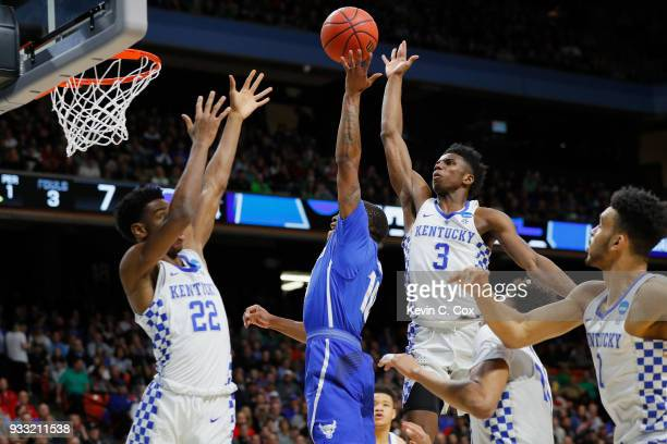 Wes Clark of the Buffalo Bulls shoots the ball against Shai GilgeousAlexander and Hamidou Diallo of the Kentucky Wildcats during the first half in...