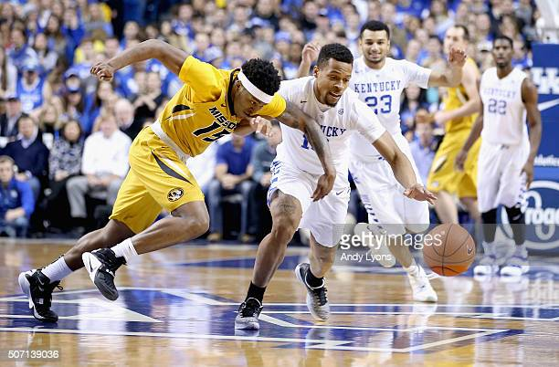 Wes Clark of the Missouri Tigers and Isaiah Briscoe of the Kentucky Wildcats battle for a loose ball during the game against the at Rupp Arena on...