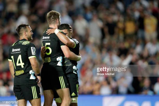 Wes Goosen Jordie Barrett and Will Miller of the Waratahs celebrate their win during the round one Super Rugby match between the Waratahs and the...