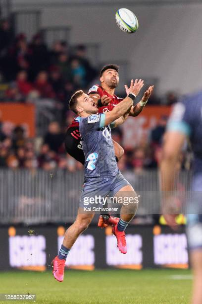 Wes Goosen of the Hurricanes and Richie Mo'unga of the Crusaders compete for the ball during the round 7 Super Rugby Aotearoa match between the...