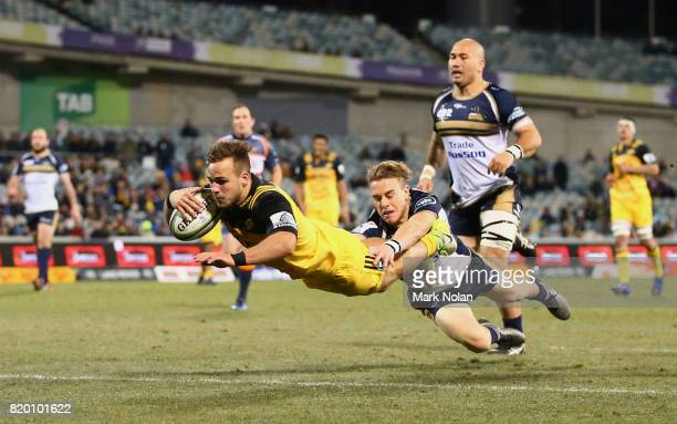 Wes Goosen of the Hurricanes dives to score a try during the Super Rugby Quarter Final match between the Brumbies and the Hurricanes at Canberra...