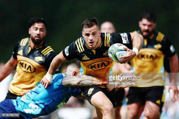 Wes Goosen of the Hurricanes is tackled by Sonny Bill Williams of the Blues during the Super Rugby trial match between the Blues and the Hurricanes...