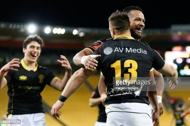 Wes Goosen of Wellington celebrates with Mateaki Kafatolu after scoring a try during the Mitre 10 Cup Semi Final match between Wellington and...
