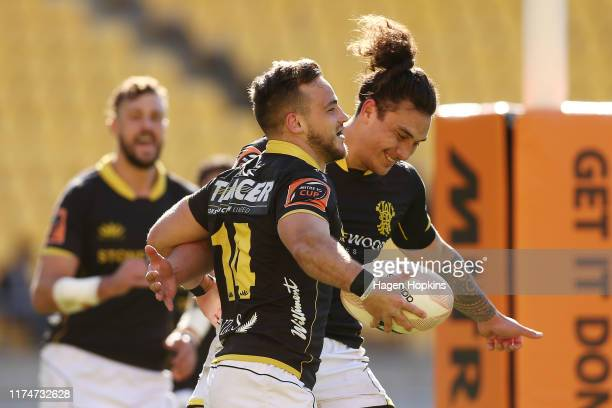 Wes Goosen of Wellington celebrates with Thomas UmagaJensen after scoring a try during the round 6 Mitre 10 Cup match between Wellington and Otago at...