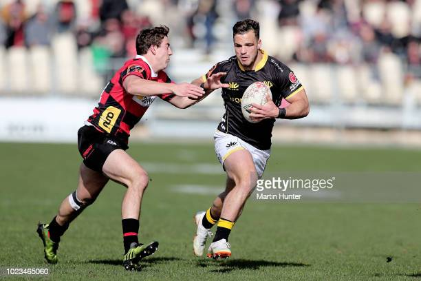 Wes Goosen of Wellington pushes away the tackle of Brett Cameron of Canterbury during the round two Mitre 10 Cup match between Canterbury and...