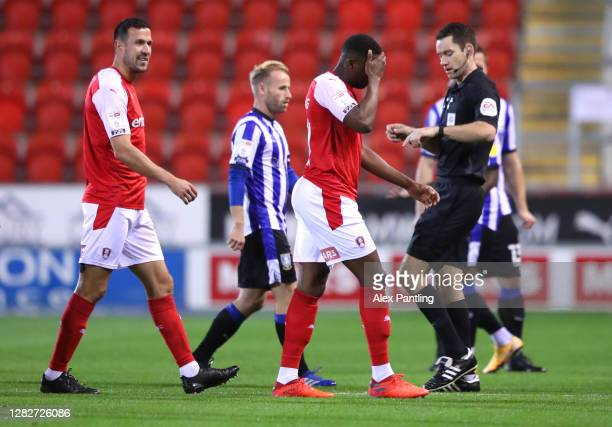 Wes Harding of Rotherham United leaves the pitch as the players are led off due to a drone flying above the stadium during the Sky Bet Championship...