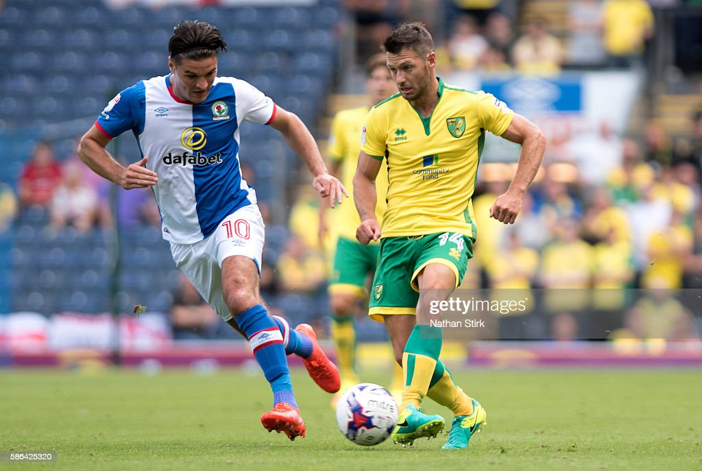 Wes Hoolahan of Norwich and Ben Marshall of Blackburn Rovers in action during the Sky Bet Championship match between Blackburn Rovers and Norwich City at Ewood park on August 6, 2016 in Blackburn, England.