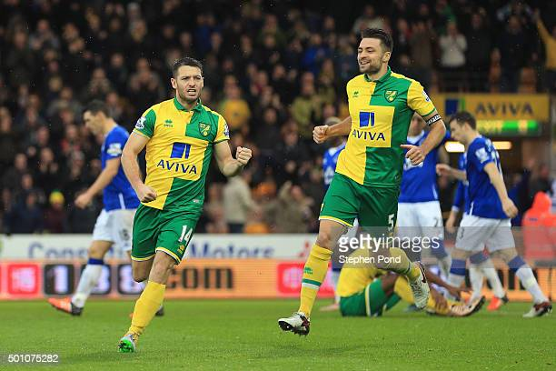 Wes Hoolahan of Norwich City celebrates scoring his team's first goal with his team mate Russel Martin during the Barclays Premier League match...
