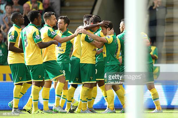 Wes Hoolahan of Norwich City celebrates scoring his team's second goal with team mates during the Barclays Premier League match between Norwich City...